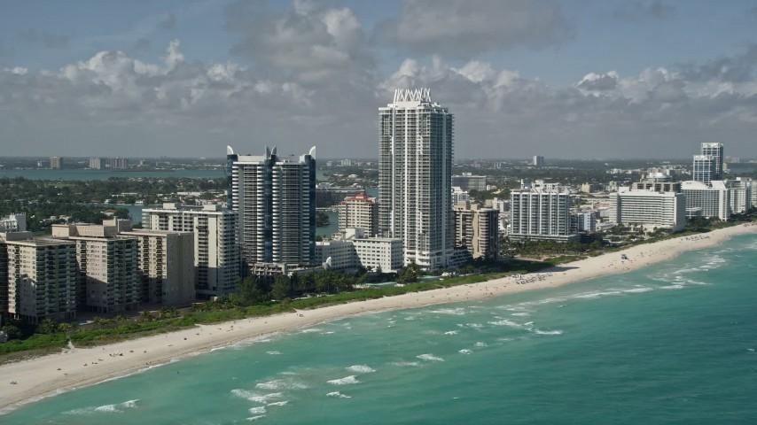 5K stock footage aerial video of approaching Akoya Miami Beach Condo, Miami Beach, Florida Aerial Stock Footage | AX0031_063