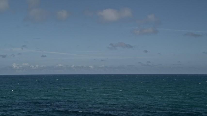 5K stock footage aerial video of flying over Atlantic Ocean, Sunny Isles Beach, Florida Aerial Stock Footage | AX0031_079