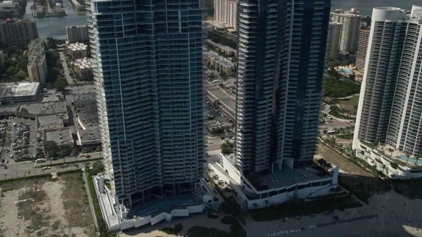 5K stock footage aerial video reveal Jade Ocean, Jade Beach Condominium Complexes, Sunny Isles Beach, Florida Aerial Stock Footage | AX0031_081