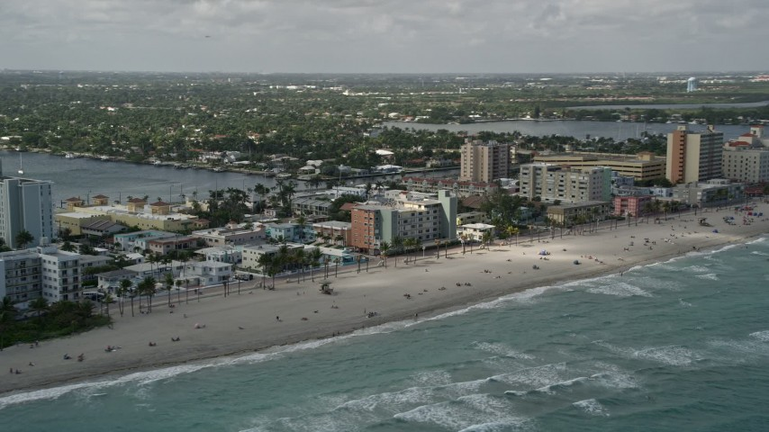 5K stock footage aerial video of flying by the beach, Hollywood, Florida Aerial Stock Footage | AX0031_093