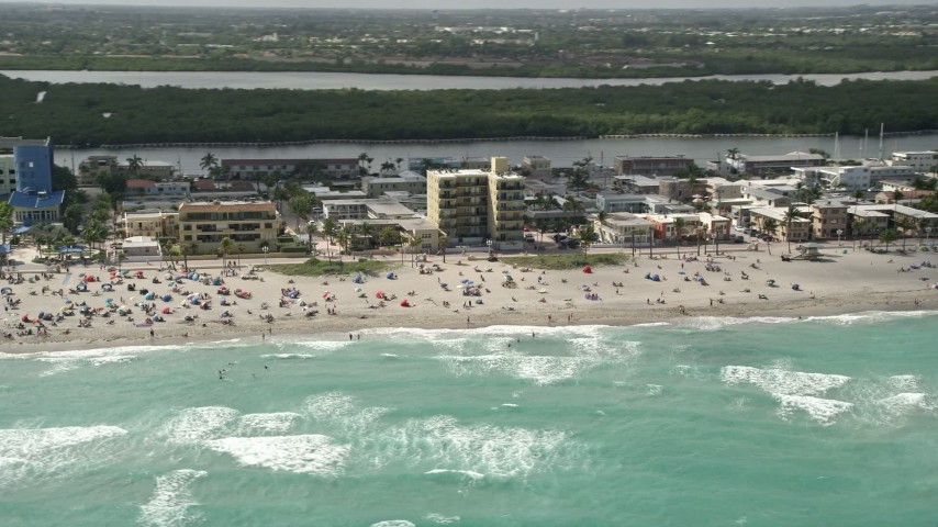 5K stock footage aerial video of a crowded beach in Hollywood, Florida Aerial Stock Footage | AX0031_095