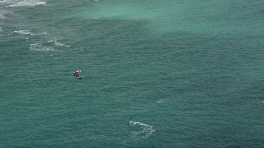 5K stock footage aerial video track a kite surfer near the coast, Hollywood, Florida Aerial Stock Footage | AX0031_097