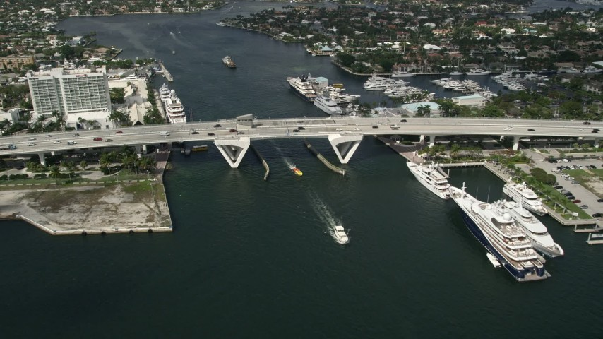 5K stock footage aerial video of approaching Southeast 17th Street bridge, yachts, Fort Lauderdale, Florida Aerial Stock Footage | AX0031_109