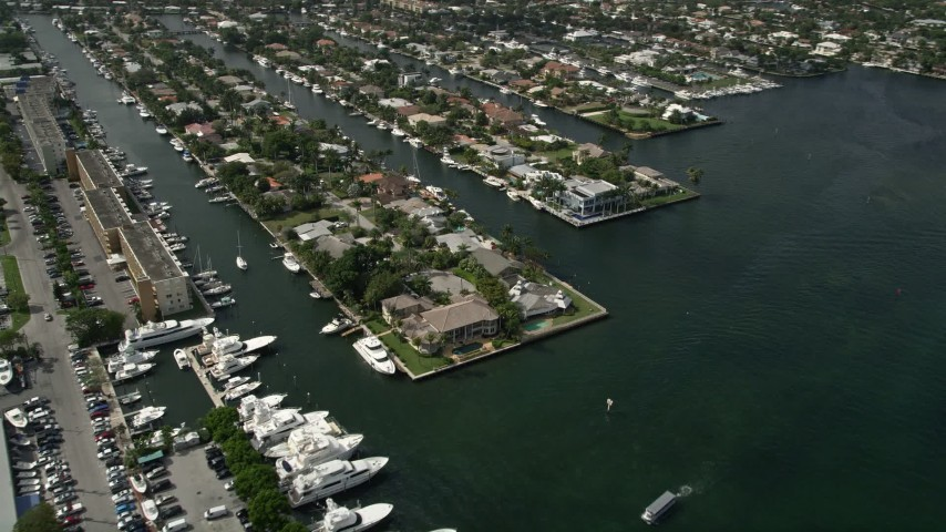 5K aerial video of flying by mansions on the river, Fort Lauderdale, Florida Aerial Stock Footage | AX0031_110