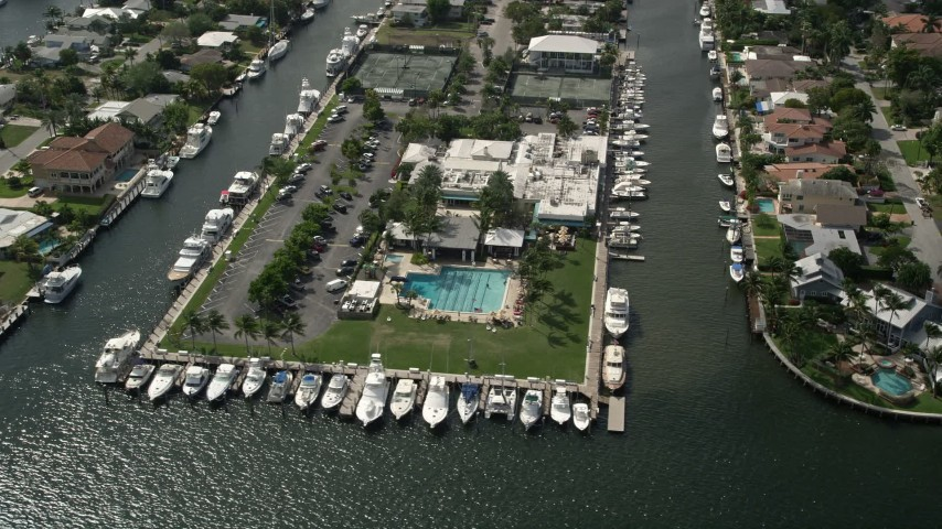 5K aerial video of the Lauderdale Yacht Club, Fort Lauderdale, Florida Aerial Stock Footage | AX0031_111