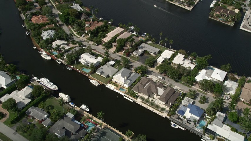 5K stock footage aerial video of approaching homes by canals, Fort Lauderdale, Florida Aerial Stock Footage | AX0031_112