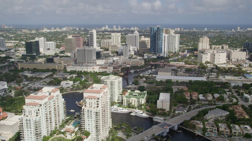 5K stock footage aerial video of flying over the New River and Downtown Fort Lauderdale, Florida Aerial Stock Footage | AX0031_118