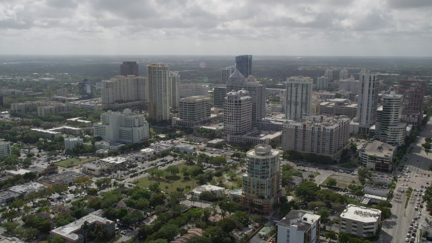 5K stock footage aerial video of flying away from Downtown skyscrapers, Fort Lauderdale, Florida Aerial Stock Footage | AX0031_122