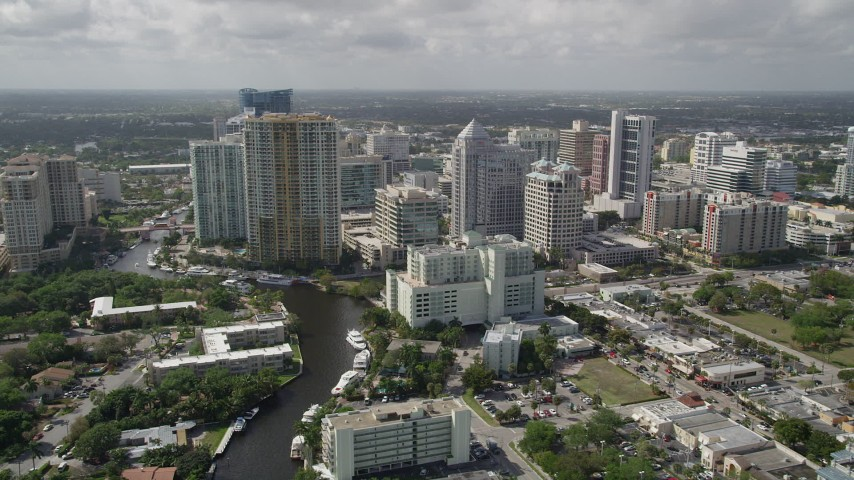 5K stock footage aerial video of flying over New River by Downtown Fort Lauderdale, Florida Aerial Stock Footage | AX0031_124