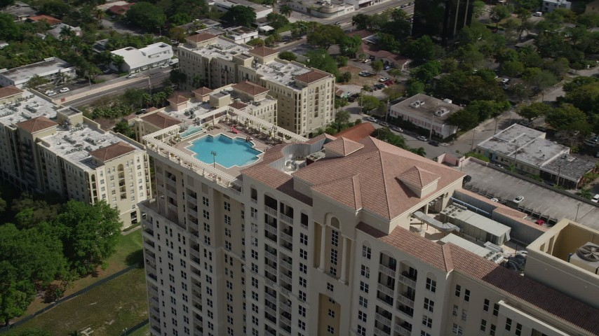 5K stock footage aerial video of flying by top of condominium complex with a pool, Fort Lauderdale, Florida Aerial Stock Footage | AX0031_126