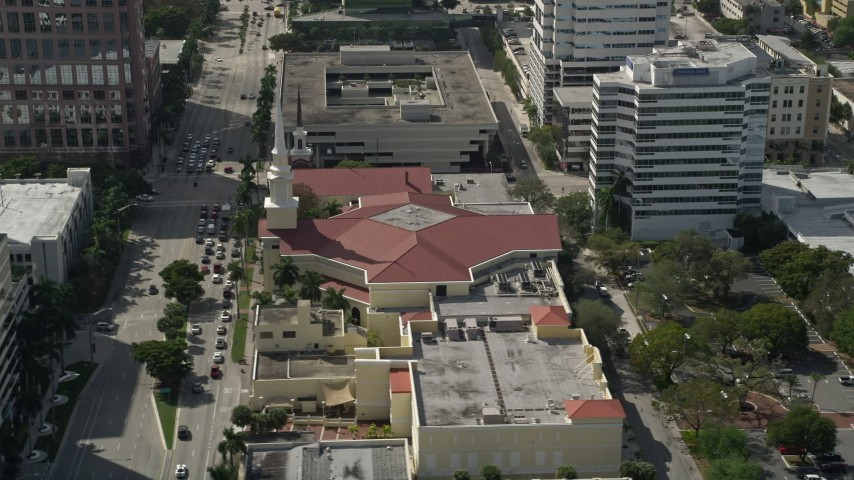 5K stock footage aerial video of passing the First Baptist Church of Fort Lauderdale, Fort Lauderdale, Florida Aerial Stock Footage | AX0031_128
