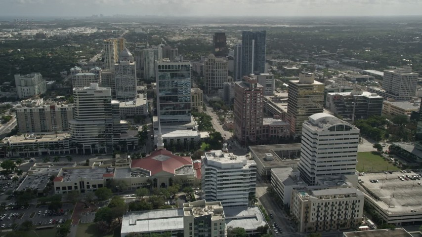 5K stock footage aerial video of flying by First Baptist Church, Downtown skyscrapers, Fort Lauderdale, Florida Aerial Stock Footage | AX0031_129