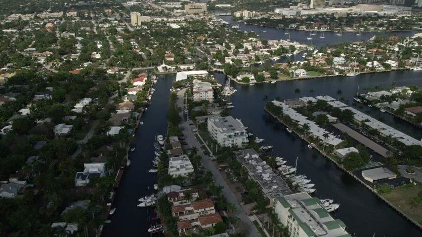 5K aerial video of flying by residential neighborhoods and canals, Fort Lauderdale, Florida Aerial Stock Footage | AX0031_133