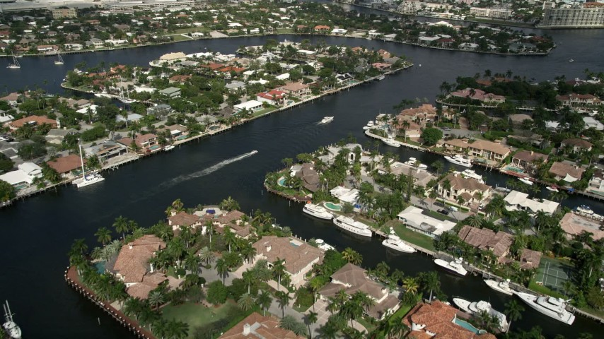 5K aerial video of flying over upscale homes on canals, Fort Lauderdale, Florida Aerial Stock Footage | AX0031_134