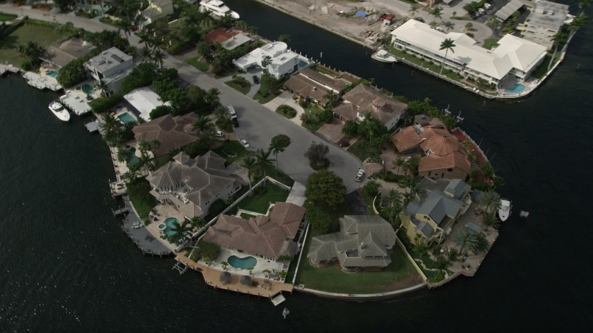5K aerial video of approaching mansions by canals, tilt down, Fort Lauderdale, Florida Aerial Stock Footage | AX0031_139