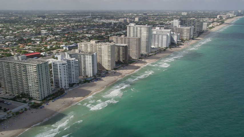 5K aerial video of flying by apartment buildings on the beach, Fort Lauderdale, Florida Aerial Stock Footage | AX0031_144