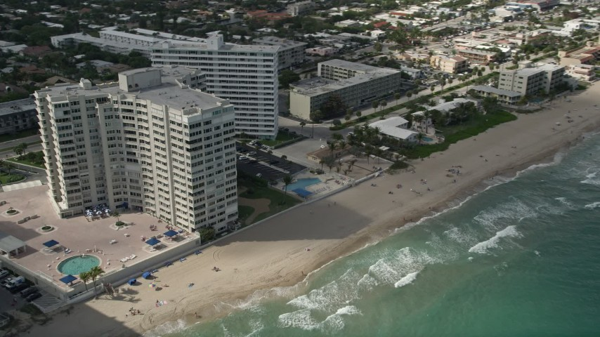 5K aerial video of sunbathers at the beach, Fort Lauderdale, Florida Aerial Stock Footage | AX0031_146