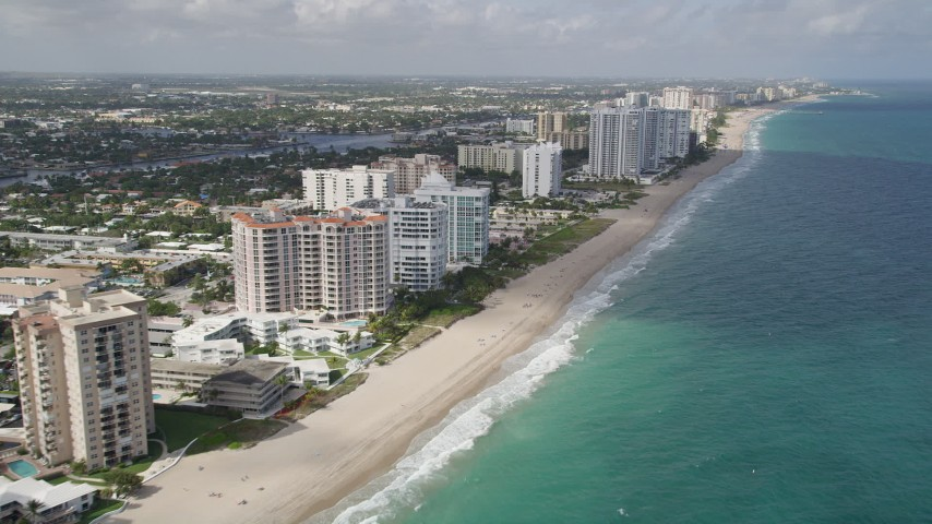 5K stock footage aerial video of following the beach along the coast, Pompano Beach, Florida Aerial Stock Footage | AX0031_150