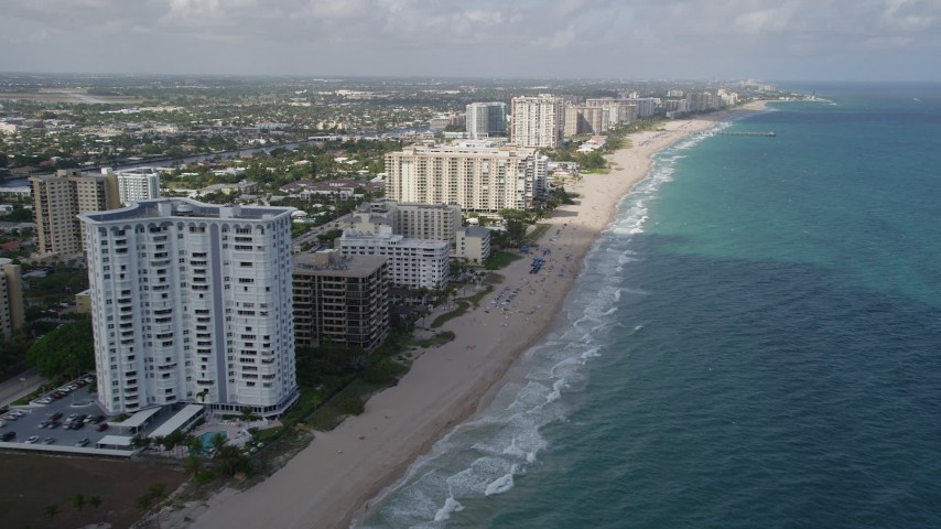 5K stock footage aerial video of following the beach along the coast, Pompano Beach, Florida Aerial Stock Footage | AX0031_151