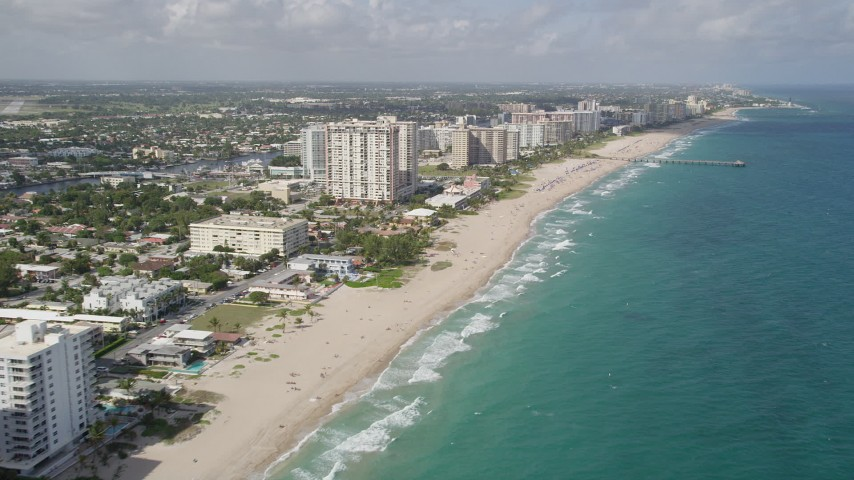 5K stock footage aerial video fly by beach, hotels, approach Pompano Beach Pier, Pompano Beach, Florida Aerial Stock Footage | AX0031_152