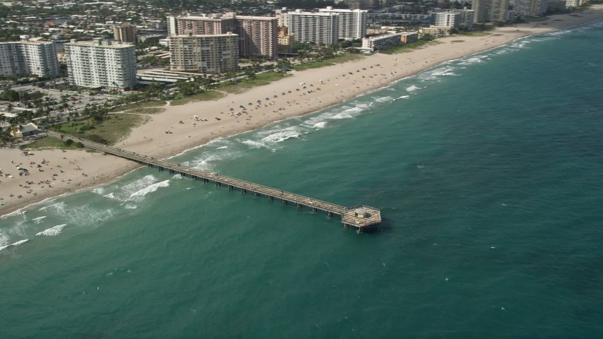 5K stock footage aerial video of approaching Pompano Beach Pier, then orbiting pier, Pompano Beach, Florida Aerial Stock Footage | AX0031_153