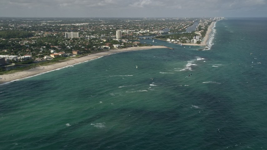 5K stock footage aerial video of kite surfers off the coast, Pompano Beach, Florida Aerial Stock Footage | AX0031_154