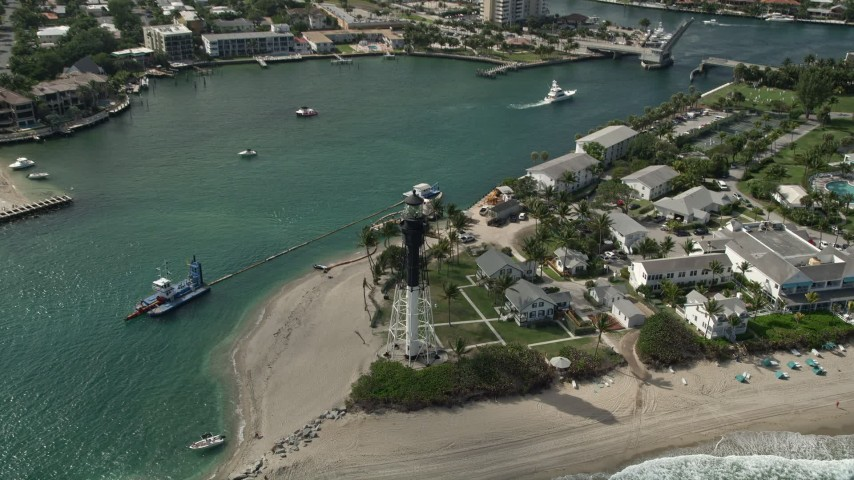 5K stock footage aerial video of flying by the Hillsboro Inlet Light, Hillsboro Beach, Florida Aerial Stock Footage | AX0031_161