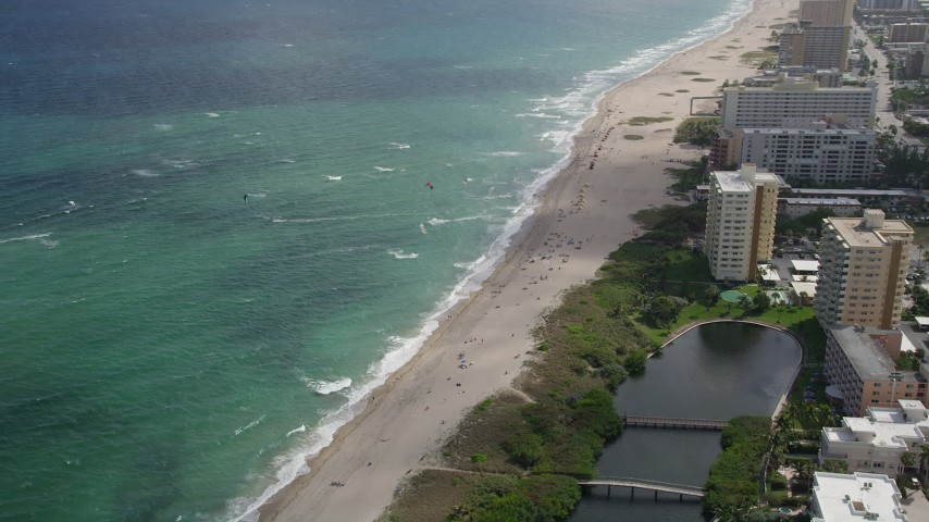 5K stock footage aerial video of flying by kite surfers, Pompano Beach, Florida Aerial Stock Footage | AX0031_163