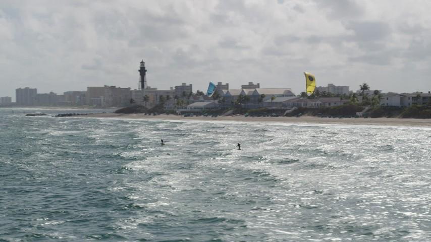 5K stock footage aerial video of tracking kite surfers near the coast, Hillsboro Beach, Florida Aerial Stock Footage | AX0031_171