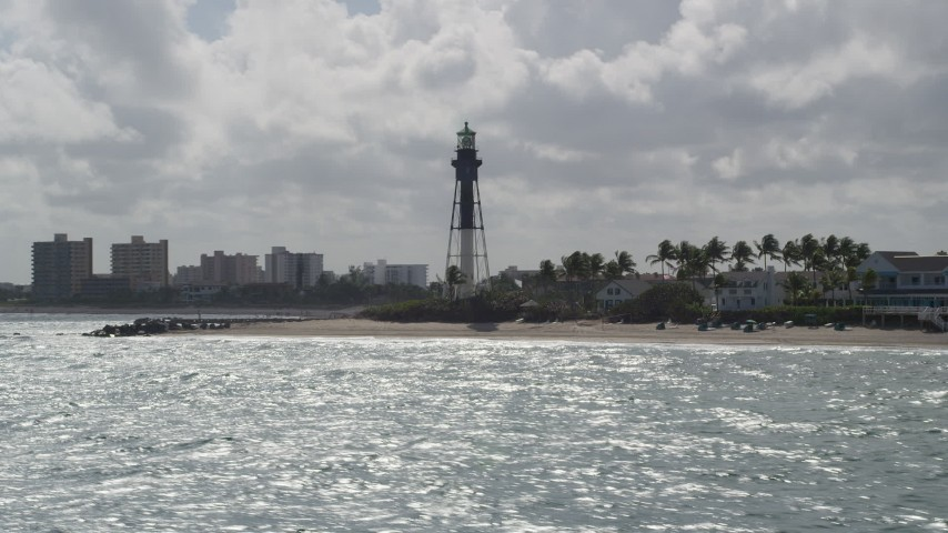5K stock footage aerial video of flying by the Hillsboro Inlet Light, Hillsboro Beach, Florida Aerial Stock Footage | AX0031_172