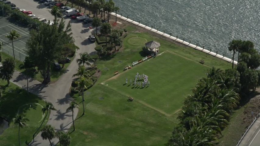 5K stock footage aerial video of orbiting croquet players at Hillsboro Club, Hillsboro Beach, Florida Aerial Stock Footage | AX0031_175