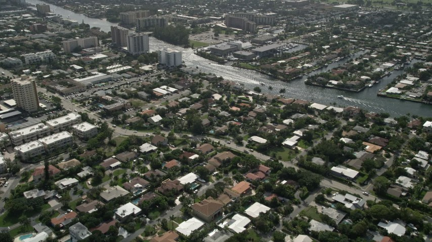 5K stock footage aerial video fly over neighborhoods, reveal Intracoastal Waterway, Pompano Beach, Florida Aerial Stock Footage | AX0031_176