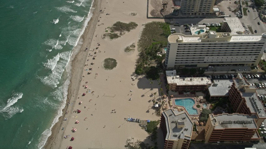 5K stock footage aerial video of bird's eye view of sunbathers, Lighthouse Cove Resort, Pompano Beach, Florida Aerial Stock Footage | AX0031_178