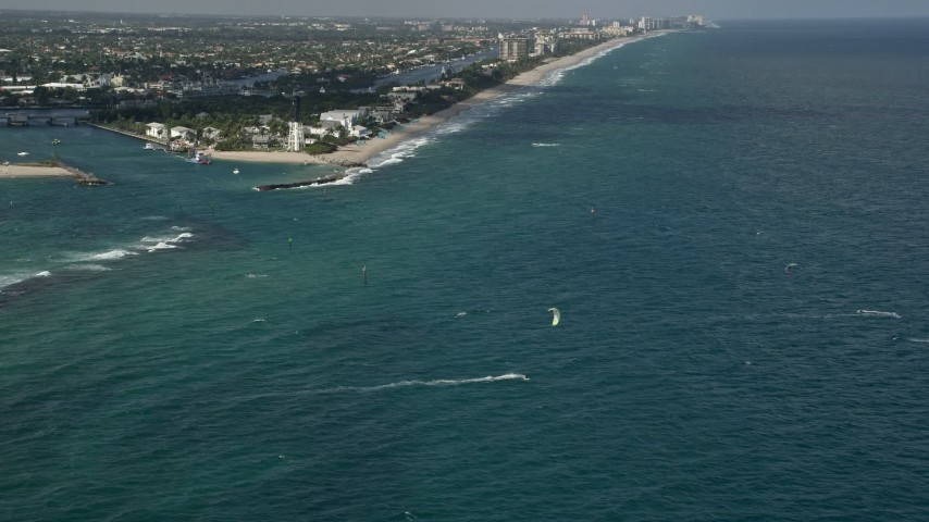 5K stock footage aerial video of flying over kite surfers near Hillsboro Inlet Light, Hillsboro Beach, Florida Aerial Stock Footage | AX0031_181