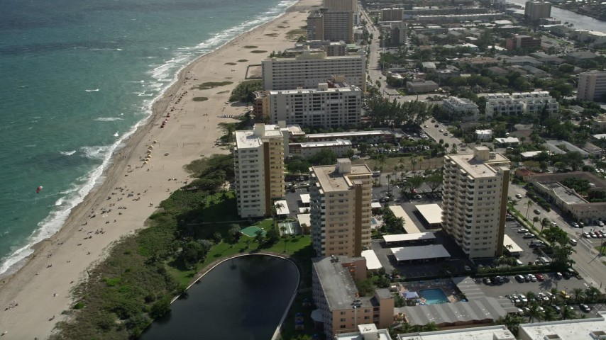 5K stock footage aerial video of orbiting apartment buildings on coast, Pompano Beach, Florida Aerial Stock Footage | AX0031_183