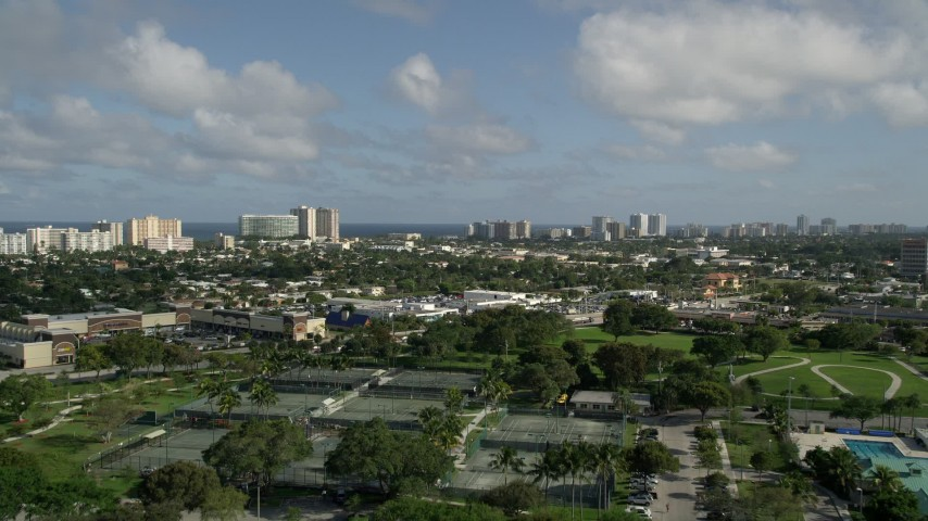 5K stock footage aerial video fly over Pompano Community Park, approach condos, Pompano Beach, Florida Aerial Stock Footage | AX0032_001