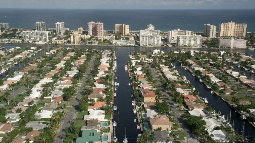 5K stock footage aerial video of flying over residential neighborhoods on canals, Pompano Beach, Florida Aerial Stock Footage | AX0032_003