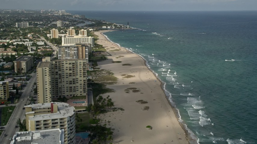 5K stock footage aerial video approach beach, revealing Hillsboro Inlet Light, Pompano Beach, Florida Aerial Stock Footage | AX0032_005