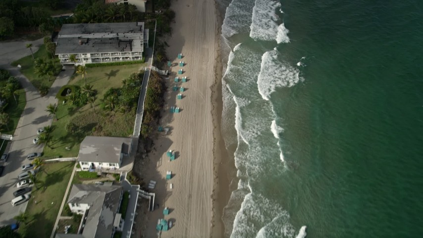 5K stock footage aerial video of flying over homes on the beach, Hillsboro Beach, Florida Aerial Stock Footage | AX0032_008
