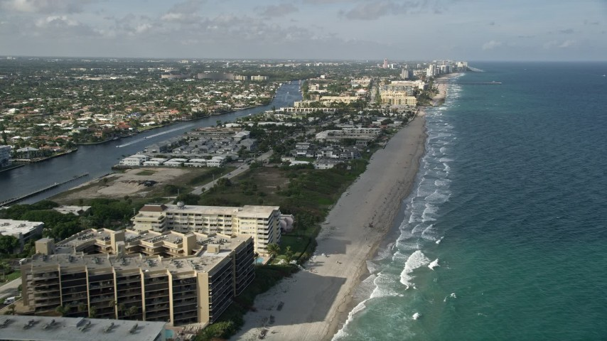 5K stock footage aerial video of flying over the beach, revealing more of Hillsboro Beach, Florida Aerial Stock Footage | AX0032_013E