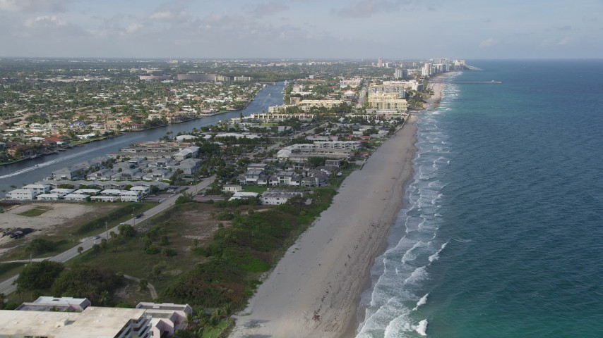 5K stock footage aerial video fly by coastal condominiums, apartment buildings, Hillsboro Beach, Florida Aerial Stock Footage | AX0032_014