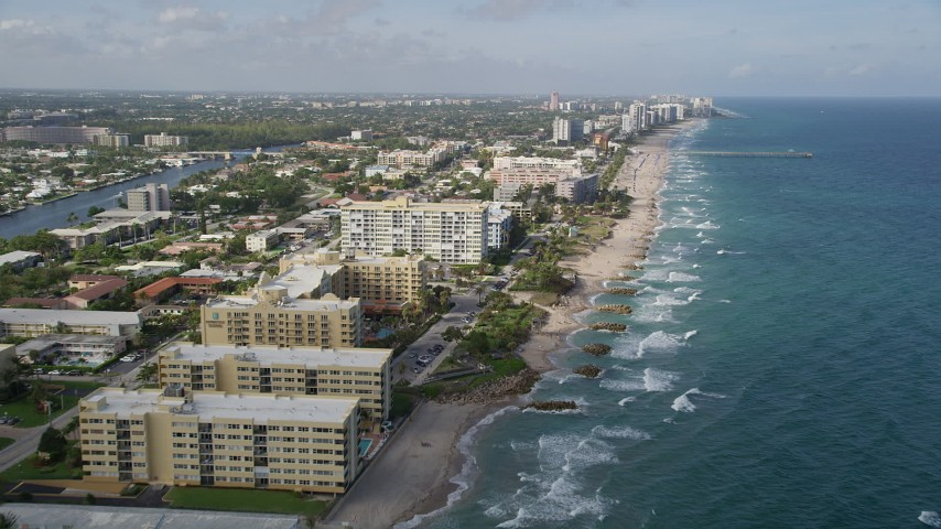 5K stock footage aerial video of following the coast, Deerfield Beach, Florida Aerial Stock Footage | AX0032_015