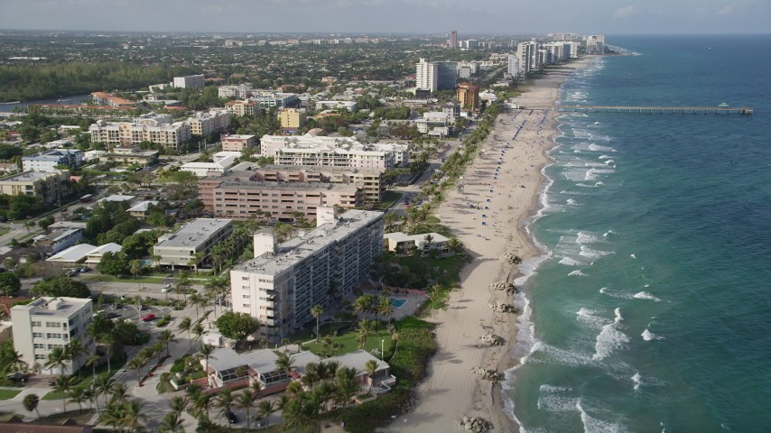 5K stock footage aerial video follow beach, approach Deerfield Beach Fishing Pier, Deerfield Beach, Florida Aerial Stock Footage | AX0032_016