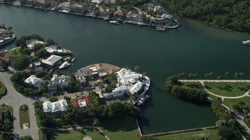 5K stock footage aerial video of flying by a mansion on the bank,  Intracoastal Waterway, Boca Raton, Florida