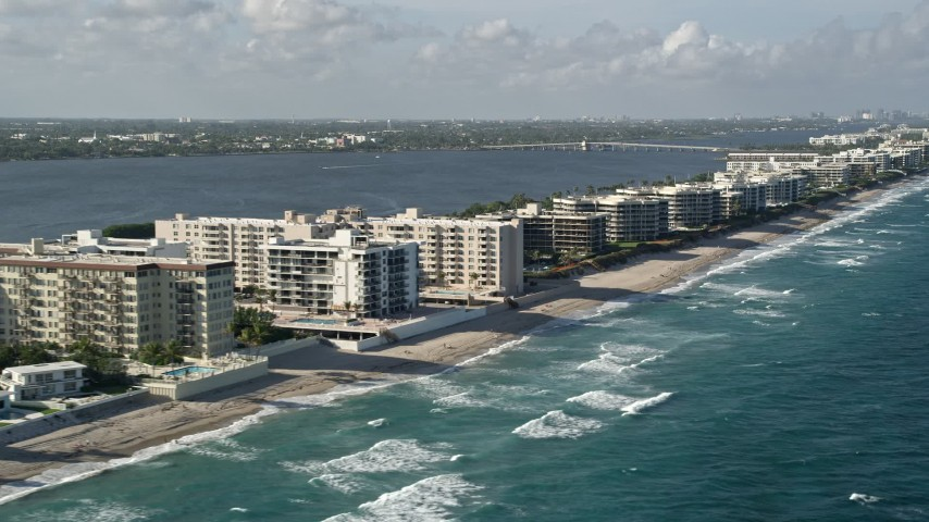 5K stock footage aerial video of flying by coastal apartments and condominiums, Palm Beach, Florida Aerial Stock Footage | AX0032_062