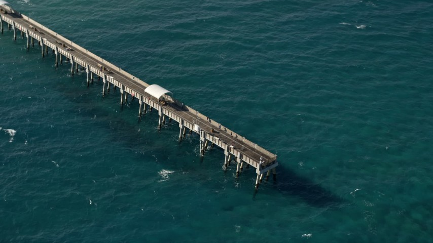 5K stock footage aerial video of orbiting the Lake Worth Pier, Palm Beach, Florida Aerial Stock Footage | AX0032_064