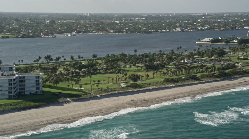 5K stock footage aerial video of flying by the coastal Palm Beach Par-3 Golf Course, Palm Beach, Florida Aerial Stock Footage | AX0032_066