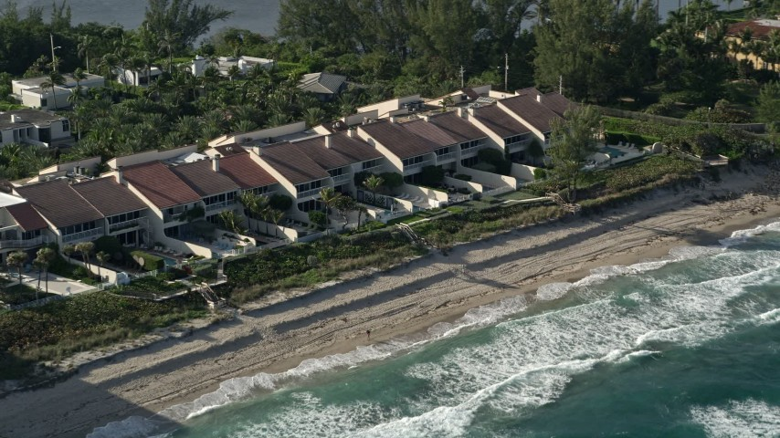 5K aerial video of passing condominiums by the beach, Palm Beach, Florida Aerial Stock Footage | AX0032_069