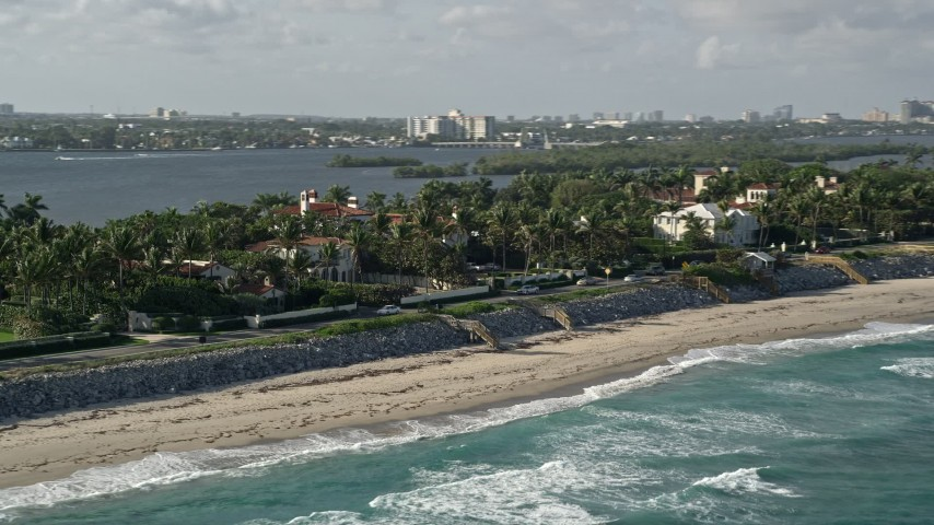 5K aerial video flyby coastal mansions, Palm Beach, Florida Aerial Stock Footage | AX0032_071