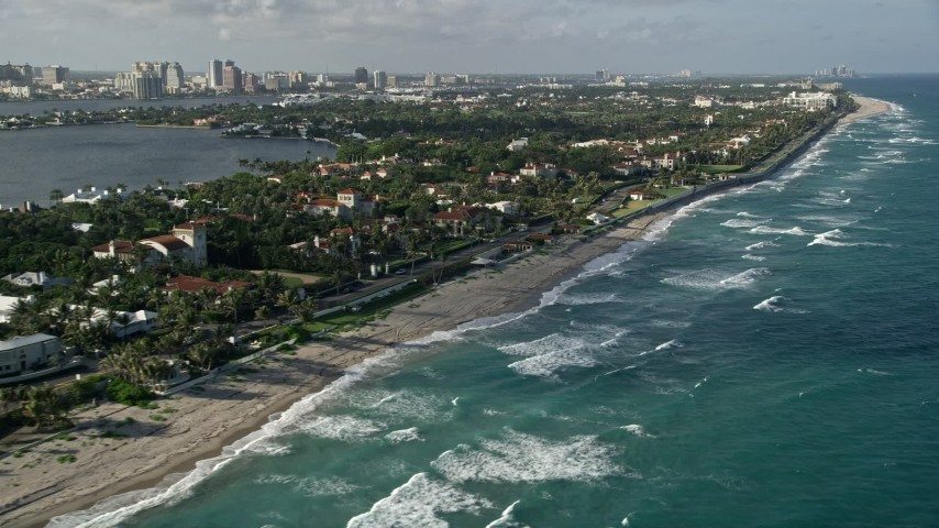 5K stock footage aerial video of following the coast past upscale residential neighborhoods, Palm Beach, Florida Aerial Stock Footage | AX0032_075